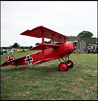 BNPS.co.uk (01202 558833)<br /> Pic: RobHenry/BNPS<br /> <br /> Friend and family turned up to witness the maiden flight.<br /> <br /> The feared Fokker Dreidecker of the Red Baron has finally flown over Britian skies - after British based German doctor 'Baron' Peter von Brueggemann spent 9 years building a replica in his garage.<br /> <br /> The German GP based in Norfolk has spent 9 years building a Fokker triplane as a tribute to infamous WW1 Ace Manfred von Ricthofen, who terrorised the skies over the Western front during the first war.<br /> <br /> Dr Peter Brueggemann, 53, fufilled his childhood dream and emulated the notorious German fighter Ace when his hand built Dreidecker finally took off this week.<br /> <br /> Dr Brueggemann has even acquired the title Baron from the independent territory of Sealand so he can take to the skies as Baron Peter von Brueggemann in homage to his idol.<br /> <br /> The GP at the Holt Medical Practice in Norfolk finally reached for the sky at Felthorpe airfield near Norwich this week in front of nervous friends and family after thousands of hours spent crafting the aircraft.<br /> <br /> The father-of-two, who has lived in England with wife Sue for 20 years, has been taking flying lessons since his project began.