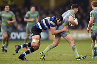 Josh Bayliss of Bath Rugby tackles Adam Radwan of Newcastle Falcons. Anglo-Welsh Cup match, between Bath Rugby and Newcastle Falcons on January 27, 2018 at the Recreation Ground in Bath, England. Photo by: Patrick Khachfe / Onside Images