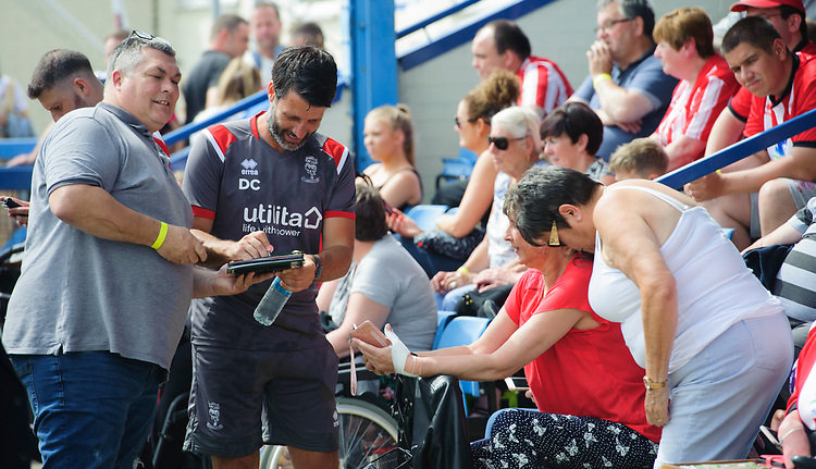 Lincoln City manager Danny Cowley signs autographs for fans<br /> <br /> Photographer Chris Vaughan/CameraSport<br /> <br /> Football Pre-Season Friendly (Community Festival of Lincolnshire) - Gainsborough Trinity v Lincoln City - Saturday 6th July 2019 - The Martin & Co Arena - Gainsborough<br /> <br /> World Copyright © 2018 CameraSport. All rights reserved. 43 Linden Ave. Countesthorpe. Leicester. England. LE8 5PG - Tel: +44 (0) 116 277 4147 - admin@camerasport.com - www.camerasport.com