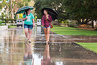 Kelsey Harrington '13 and Ari Laub '14 on a rainy walk at Oxy - a brief thunderstorm took us by surprise late this afternoon but left a faint rainbow above Fiji. Aug. 20, 2012. (Photo by Marc Campos, Occidental College Photographer)
