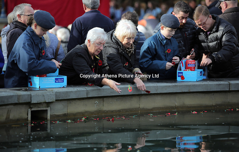 Pictured: Young cadets and women deposit poppies in the fountain Friday 11 November 2016<br />