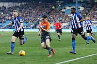 Daniel James of Swansea City (C) runs against Tom Lees (L) and Dominic Iorfa of Sheffield Wednesday (R) during the Sky Bet Championship match between Sheffield Wednesday and Swansea City at Hillsborough Stadium, Sheffield, England, UK. Saturday 23 February 2019