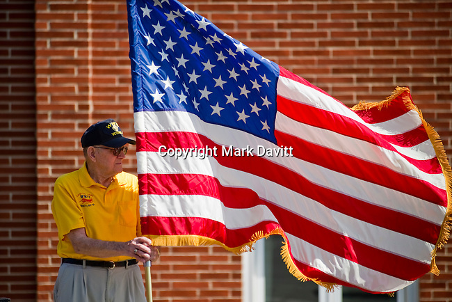 Paul Lawrence of American Legion Post 165 held the flag during the Memorial Day service May 28.
