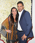 Kyle Richards and Mauricio Umansky attends the QVC Red Carpet Style Event held at The Four Seasons at Los Angeles in Los Angeles, California on February 23,2012                                                                               © 2012 DVS / Hollywood Press Agency