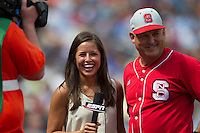 North Carolina State head coach Elliott Avent smiles while being interviewed by ESPN reporter Kaylee Hartung during Game 3 of the 2013 Men's College World Series between the North Carolina State Wolfpack and North Carolina Tar Heels at TD Ameritrade Park on June 16, 2013 in Omaha, Nebraska. The Wolfpack defeated the Tar Heels 8-1. (Andrew Woolley/Four Seam Images)
