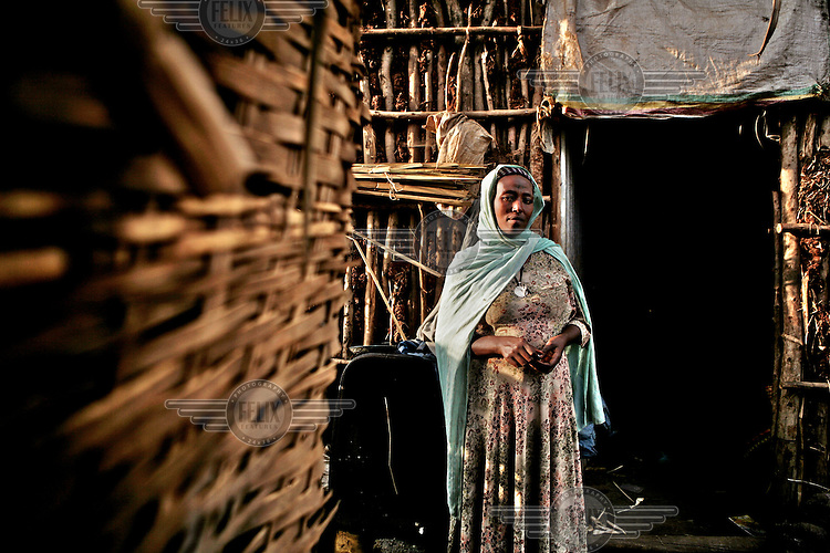 A woman from one of the poorest communities in Ethiopia, the Negede Wiotto, outside of her home in an informal settlement.