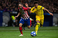 Juanfran Torres of Atletico de Madrid  and Jadon Sancho of Borussia Dortmund during the match between Atletico de Madrid and Borussia Dortmund of UEFA Champions League 2018-2019, group A, date 4 played at the Wanda Metropolitano Stadium. Madrid, Spain, 6 NOV 2018.