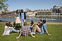 Photos for Kingston University  London international student brochures and prospectuses.??Relaxing and socialising - Thames River bank backdrop with Kingston Town skyline (Hampton Wick side)Sitting on the river bank, relaxing and socialising in group(s) capturing skyline, river  and busy lunch time period along river bank restaurants..??Date Taken: 19/04/10??Location: Kingston riverside, Hampton Wick side.??Contact:??Commissioned by:  Kingston University - Emma Carlino?Emma Carlino.International Marketing Communications Manager.International Centre.Kingston University London.Swan Wing, River House.53-57 High Street.Kingston upon Thames.London.KT1 1LQ.UK.Tel: +44(0)20 8417 3006.Fax: +44(0)20 8417 3028.Email: e.carlino@kingston.ac.uk.Website: www.kingston.ac.uk/international