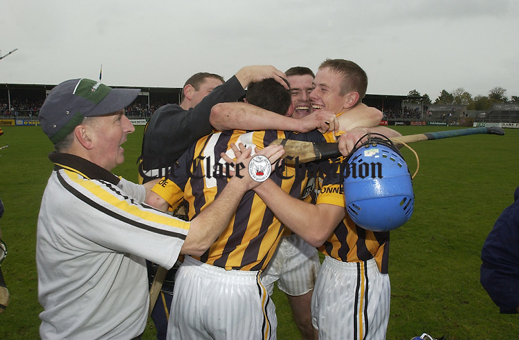 The Ogonnelloe lads and their mentor Gerry Cosgrove, left,  celebrate their win against Tulla in the Senior B hurling final, after the final whistle, at Cusack park. Photograph by John Kelly.