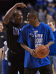 "Former Wildcats Jack Givens and Jodie Meeks joke after Meeks missed a shot while playing a game of ""CATS"" following the ESPN Gameday presentation in Rupp Arena on Saturday, Feb. 13, 2009...Photo by Ed Matthews 