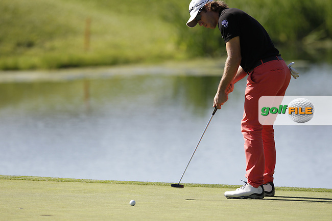 Romain Wattel (FRA) takes his putt on the 4th green during Thursday's Round 1 of the 2014 Open de Espana held at the PGA Catalunya Resort, Girona, Spain. Wednesday 15th May 2014.<br /> Picture: Eoin Clarke www.golffile.ie