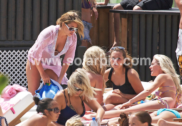 **ALL ROUND PICTURES FROM SOLARPIX.COM**.**WORLDWIDE SYNDICATION RIGHTS**.Bianca Gascoigne and friends enjoyed a day on the beach in sunny Marbella this weekend. The singer has been touring clubs and beaches promoting her new single. She was seen eating a healthy lunch and there was not a beer in sight..JOB REF:    6500   AB1        DATE: 23.05.08.**MUST CREDIT SOLARPIX.COM OR DOUBLE FEE WILL BE CHARGED* *UNDER NO CIRCUMSTANCES IS THIS IMAGE TO BE REPRODUCED FOR ANY ONLINE EDITION WITHOUT PRIOR PERMISSION*