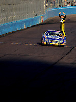 Nov. 8, 2008; Avondale, AZ, USA; NASCAR Nationwide Series driver Carl Edwards celebrates after winning the Hefty Odor Block 200 at Phoenix International Raceway. Mandatory Credit: Mark J. Rebilas-