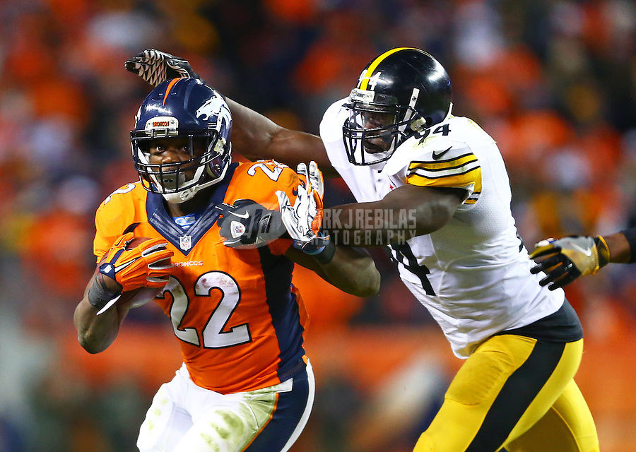 Jan 17, 2016; Denver, CO, USA; Denver Broncos running back C.J. Anderson (22) is tackled by Pittsburgh Steelers inside linebacker Lawrence Timmons (94) during the fourth quarter of the AFC Divisional round playoff game at Sports Authority Field at Mile High. Mandatory Credit: Mark J. Rebilas-USA TODAY Sports