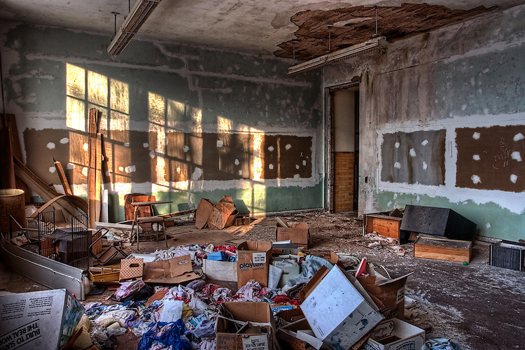 A derelict room with boxes
