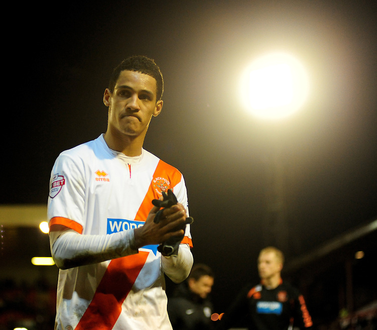 Blackpool's Thomas Ince walks off the pitch at the final whistle<br /> <br /> Photo by Chris Vaughan/CameraSport<br /> <br /> Football - The Football League Sky Bet Championship - Barnsley v Blackpool - Saturday 18th January 2014 - Oakwell Stadium - Barnsley<br /> <br /> &copy; CameraSport - 43 Linden Ave. Countesthorpe. Leicester. England. LE8 5PG - Tel: +44 (0) 116 277 4147 - admin@camerasport.com - www.camerasport.com