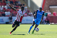 Nigel Atangana of Leyton Orient takes the ball away from Amari Morgan-Smith of Cheltenham during the Sky Bet League 2 match between Cheltenham Town and Leyton Orient at the LCI Rail Stadium, Cheltenham, England on 6 August 2016. Photo by Mark  Hawkins / PRiME Media Images.