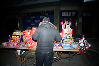 A person buys fireworks from a seller on the street on the night of Lunar New Year celebrations in Nanjing, Jiangsu, China. Lunar New Year is also known as Chinese New Year.  2009 is the Year of the Ox, the Year of the Cow, or the Year of the Bull, according to the Chinese zodiac.  Niu is the Mandarin word for ox/cow/bull.