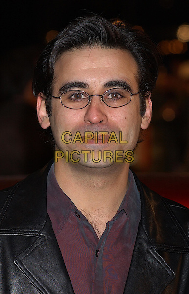 RAJI JAMES.Starsky & Hutch premiere in Odeon Leicester Square.11 March 2004.portrait, headshot, glasses.www.capitalpictures.com.sales@capitalpictures.com.©Capital Pictures.