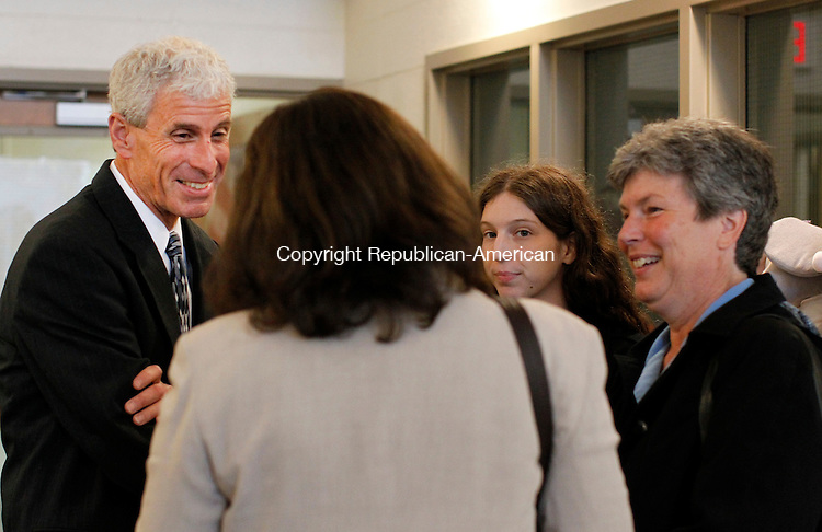 Oxford, CT-04 June 2012-060412CM10-  Newly appointed superintendent of Oxford schools, Tim Connellan (left) chats with school Business Manager Rosemary Hanson, wife Terri (right) and daughter, Katie before the start of the the board of education meeting Monday night at the Quaker Farms School on Oxford.  Connellan was appointed the position after a unanimous vote.    Christopher Massa Republican-American