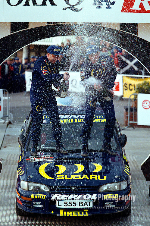 Pix: Shaun Flannery/shaunflanneryphotography.com..COPYRIGHT PICTURE>>SHAUN FLANNERY>01302-570814>>07778315553>>..23rd November 1995..............Colin McRae and co driver Derek Ringer (Subaru Impreza) celebrate victory in the 1995 Network Q RAC Rally.