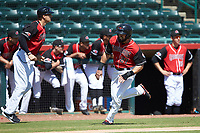 Tanner Gardner (27) of the Hickory Crawdads hustles towards home plate against the Charleston RiverDogs at L.P. Frans Stadium on May 13, 2019 in Hickory, North Carolina. The Crawdads defeated the RiverDogs 7-5. (Brian Westerholt/Four Seam Images)
