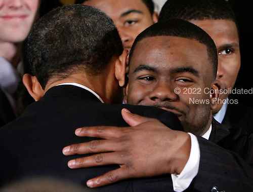 United States President Barack Obama (L) hugs Heisman Trophy winner and running back Mark Ingram (R) during an East Room event to host members of the Alabama Crimson Tide, Monday, March 8, 2010 at the White House in Washington, DC. Obama welcomed the 2009 BCS Champion to honor its 13th championship and an undefeated season..Credit: Alex Wong - Pool via CNP