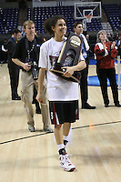 31 March 2008: Cissy Pierce walks off with the trophy during Stanford's 98-87 win over the University of Maryland in the elite eight game of the NCAA Division 1 Women's Basketball Championship in Spokane, WA.