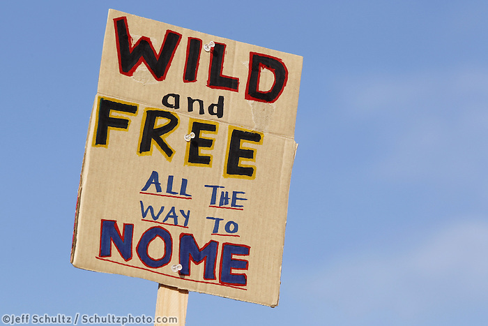 """Sunday, March 4, 2012  A """"Wild and Free all the way to Nome"""" sign at the restart of Iditarod 2012 in Willow, Alaska."""