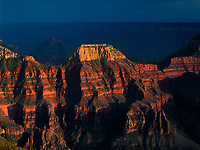 749220199 sunset light turns wotans throne a golden tan with angels gate shrouded in the back seen from the lodge along the north rim of grand canyon national park arizona