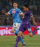 Juan Manuel Vargas shoots to score  during the the Italian Cup final soccer match between Napoli and  Fiorentina at the Olympic stadium in Rome May 3, 2014