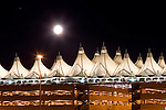 Full moon over Denver International Airport, Denver, Colorado. .  John offers private photo tours in Denver, Boulder and throughout Colorado. Year-round Colorado photo tours.