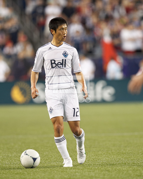 Vancouver Whitecaps FC defender Young-Pyo Lee (12) looks to pass. In a Major League Soccer (MLS) match, the New England Revolution defeated Vancouver Whitecaps FC, 4-1, at Gillette Stadium on May 12, 2012.