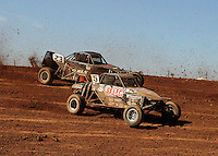 Apr 16, 2011; Surprise, AZ USA; LOORRS driver Jerry Whelchel  (5) leads Steven Greinke (23) during round 3 at Speedworld Off Road Park. Mandatory Credit: Mark J. Rebilas-.
