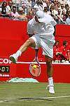 Andy Roddick makes a great trick shot. Queens - London..© CameraSport - 43 Linden Ave. Countesthorpe. Leicester. England. LE8 5PG - Tel: +44 (0) 116 277 4147 - admin@camerasport.com - www.camerasport.com