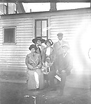COLLEY AND MALONE FAMILIES. Walter R. Colley (1871-1970) is pictured at right, with his son-in-law Clyde Malone (1890-1951) standing behind him. Colley's wife Lula (1875-1958) shared the bench with her husband; between them stood their daughter Izetta (1892-1966). Clyde was 20 and Izetta 18 when they married in 1910, around the time this photograph was taken. As Clyde Malone wrote in 1946, &quot;After graduation from high school, I was fatally bitten by the matrimonial bug and deluded Miss Izetta Colley, of the Missouri Colleys, into saying 'I do', (and she has for lo' these many years).&quot; Their marriage lasted over 40 years until Clyde's death in 1951. <br />