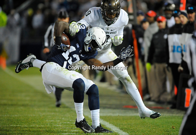 STATE COLLEGE, PA - NOVEMBER 26:  Penn State WR Chris Godwin (12) stays in bounds as Michigan State S Montae Nicholson (9) tries to tackle him out of bounds. The Penn State Nittany Lions defeated the Michigan State Spartans 45-12 to win the Big Ten East Division on November 26, 2016 at Beaver Stadium in State College, PA. (Photo by Randy Litzinger/Icon Sportswire)