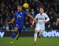 Bolton Wanderers' Adam Le Fondre vies for possession with Cardiff City's Lee Peltier<br /> <br /> Photographer Kevin Barnes/CameraSport<br /> <br /> The EFL Sky Bet Championship - Cardiff City v Bolton Wanderers - Tuesday 13th February 2018 - Cardiff City Stadium - Cardiff<br /> <br /> World Copyright &copy; 2018 CameraSport. All rights reserved. 43 Linden Ave. Countesthorpe. Leicester. England. LE8 5PG - Tel: +44 (0) 116 277 4147 - admin@camerasport.com - www.camerasport.com