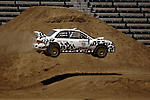 Driver Matt Iorio and co-driver Ole Holter get some air while competing in the Rally Car Race finals during X-Games 12 in Los Angeles, California on August 5, 2006.