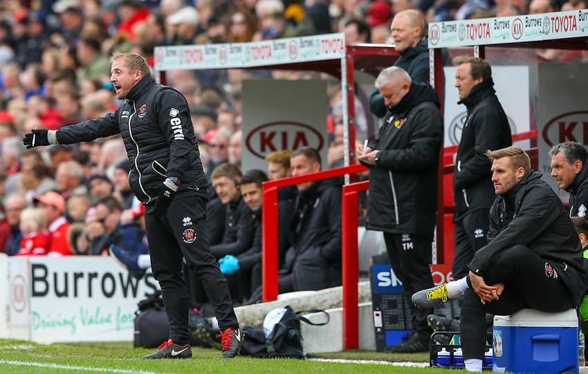 Blackpool first team coach Ian Dawes shouts instructions to his team from the technical area<br /> <br /> Photographer Alex Dodd/CameraSport<br /> <br /> The EFL Sky Bet League One - Barnsley v Blackpool - Saturday 27th April 2019 - Oakwell - Barnsley<br /> <br /> World Copyright © 2019 CameraSport. All rights reserved. 43 Linden Ave. Countesthorpe. Leicester. England. LE8 5PG - Tel: +44 (0) 116 277 4147 - admin@camerasport.com - www.camerasport.com