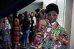 MILAN, ITALY - SEPTEMBER 23: Ogbewi Imade, a Nigerian model waits backstage before a show with the Italian Haitian designer Stella Jean at Milan Fashion Week Spring/Summer Milan 2016, in Milan, Italy.  (Photo by: Per-Anders Pettersson)