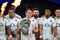 Dylan Hartley of England holds the Triple Crown trophy after the match. RBS Six Nations match between England and Wales on March 12, 2016 at Twickenham Stadium in London, England. Photo by: Patrick Khachfe / Onside Images