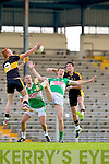 Padraig Lucey Legion looses this kickout to Ambrose O'Donovan and  Johnny Buckley Dr Crokes during their County Championship clash in Fitzgerald Stadium on Saturday