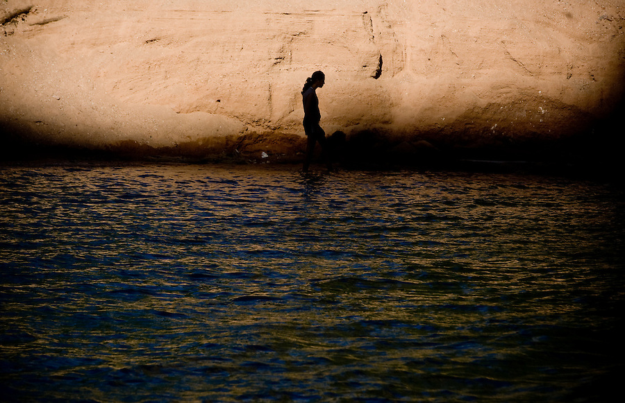 8/2/09 Havasupai-- A camper is silhouetted against a rock wall while cooling off at Havasu Falls, one of the waterfalls in Havasupai.  (Pat Shannahan/ The Arizona Republic)