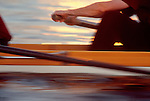 Rowing, Workout, Man in an eight oared racing shell at the catch, hands in  blur motion.