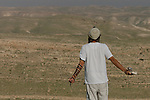 Facing the Judean desert, a settler prays at the unauthorized Israeli outpost of Tekoa D, West Bank.<br />