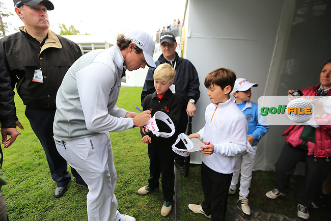 Rory McIlroy (NIR) playing with Chris Robshaw, Tim Abbott and Andrew Strauss signing autographs during the PRO-AM at the BMW PGA Championship 2013, Wentworth Club, Virginia Water, Surrey, England..Picture:  Fran Caffrey/www.golffile.ie