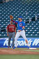 AZL Cubs 2 first baseman Abraham Rodriguez (12) catches a throw during an Arizona League game against the AZL Dbacks on June 25, 2019 at Sloan Park in Mesa, Arizona. AZL Cubs 2 defeated the AZL Dbacks 4-0. (Zachary Lucy/Four Seam Images)