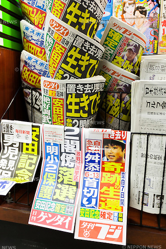 Japanese evening tabloids lead with the news that Yamato Tanooka, the missing 7-year-old Japanese boy was found alive in Hokkaido, on June 3, 2016, Tokyo, Japan. The boy was found alone in an empty hut in a training area for Japanese Self-Defense Forces in the town of Shikabe, Hokkaido, 5 kilometres from where he was abandoned by his parents 7 days earlier as punishment. Tanooka's father regretted the incident and said he had to apologised to Yamato and wanted to extend an apology to society as well. (Photo by Rodrigo Reyes Marin/AFLO)