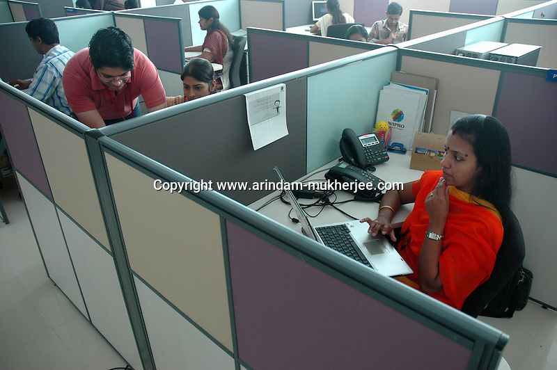 software company office. indian software professionals at work in wipro bangalore office is the second largest company